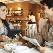 Couple Meeting In Busy Cafe Restaurant — Stock Photo #50474511