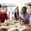 Group Of Friends Meeting For Lunch In Coffee Shop — Stock Photo #50474585