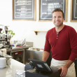 Customer Paying In Coffee Shop Using Touchscreen — Stock Photo #50474667