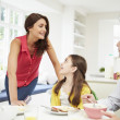 Family Having Breakfast Before Husband Goes To Work — Stock Photo #50474697