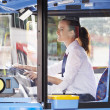 Portrait Of Female Bus Driver Behind Wheel — Stock Photo #50474733
