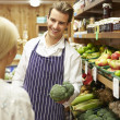 Assistant Helping Customer At Vegetable Counter Of Farm Shop — Stock Photo #50474873