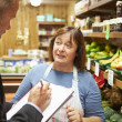 Bank Manager Meeting With Female Owner Of Farm Shop — Stock Photo #50474983