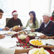 Multi Generation Family Praying Before Christmas Meal — Stock Photo #50475097