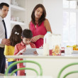 Family Helping To Clear Up After Breakfast — Stock Photo #50475129