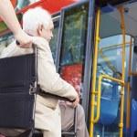 Senior Couple Boarding Bus Using Wheelchair Access Ramp — Stock Photo #50475521
