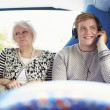 Man Disturbing Passengers On Bus Journey With Loud Music — Stock Photo #50475591
