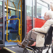Senior Couple Boarding Bus Using Wheelchair Access Ramp — Stock Photo #50475593