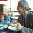 Mature Couple Enjoying Meal At Outdoor Restaurant — Stock Photo #50475747