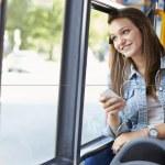 Teenage Girl Wearing Earphones Listening To Music On Bus — Stock Photo #50475763