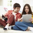 Children Playing With Digital Tablet And MP3 Player — Stock Photo #50475873