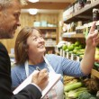 Bank Manager Meeting With Female Owner Of Farm Shop — Stock Photo #50476193