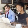 Businesswoman Using Laptop In Coffee Shop — Stock Photo #50476285