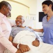 Nurse Talking To Senior Couple In Hospital Room — Stock Photo #50476289