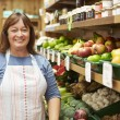 Female Sales Assistant At Vegetable Counter Of Farm Shop — Stock Photo #50476727