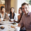 Group Of Friends Meeting In Cafe — Stock Photo #50476805