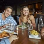 Family Enjoying Meal In Restaurant — Stock Photo #50476827
