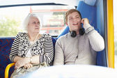 Man Disturbing Passengers On Bus Journey With Phone Call — Stock Photo