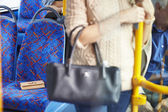 Passenger Leaving Change Purse On Seat Of Bus — 图库照片