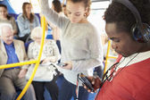 Passengers Using Mobile Devices On Bus Journey — Stok fotoğraf