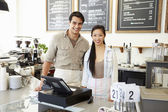 Male And Female Staff In Coffee Shop — Stock Photo