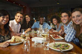 Group Of Friends Enjoying Meal In Restaurant — Stock Photo