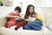 Children Playing With Digital Tablet And MP3 Player — Stock Photo