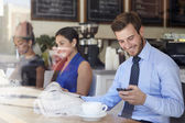 Businessman With Mobile Phone And Newspaper In Coffee Shop — Photo