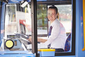 Portrait Of Female Bus Driver Behind Wheel — Stock Photo
