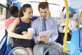 Businessman And Woman Using Digital Tablet On Bus — Stock Photo
