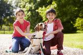 Hispanic Children Taking Dog For Walk In Countryside — Stock Photo