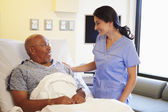 Nurse Talking To Senior Male Patient In Hospital Room — Stock Photo