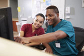 Male And Female Nurse Working At Nurses Station — Stock Photo