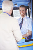 Senior Man Boarding Bus And Buying Ticket — Stock Photo