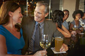 Mature Couple Enjoying Drink In Bar Together — Stock Photo