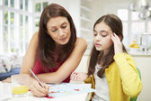 Mother Helping Daughter Struggling With Homework — Stock Photo
