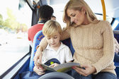Mother And Son Going To School On Bus Together — Stock Photo