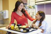 Young Girl With Mother Eating Lunch In Hospital Bed — Stock Photo