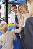 Mother And Son Boarding Bus And Buying Ticket — Foto Stock
