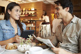 Couple Meeting In Busy Cafe Restaurant — Stock Photo