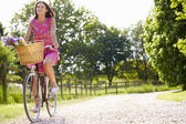 Attractive Woman Riding Bike Along Country Lane — Stock Photo