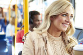 Woman Enjoying Takeaway Drink On Bus Journey — Stock Photo