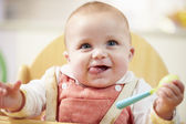 Portrait Of Happy Young Baby Boy In High Chair — Stock Photo