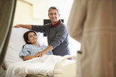 Husband Visiting Wife In Hospital And Talking To Doctor — Stock Photo