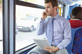 Businessman with Phone And Digital Tablet On Bus — Stock Photo