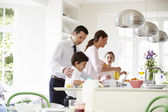 Family Helping To Clear Up After Breakfast — Stock Photo