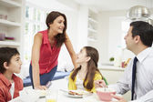 Family Having Breakfast Before Husband Goes To Work — Stock Photo