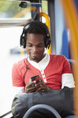 Man Wearing Headphones Listening To Music On Bus Journey — Stock Photo