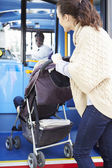 Mother With Child In Pushchair Boarding Bus — Stock Photo
