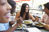 Group Of Friends Enjoying Meal At Outdoor Restaurant — Foto Stock